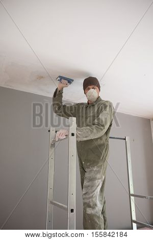 Man Painting Facade Builder Worker With Roller