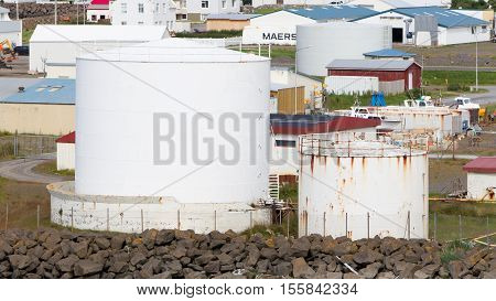 AKRANES ICELAND - July 27 2016: White gas storage tank in the west of Iceland on July 27 2016. Iceland mostly runs on Geothermal power.