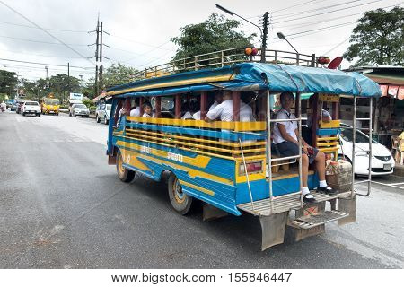 Khao Lak Thailand - september 12 2016: Traditional schoolbus on the road with young students in Thailand