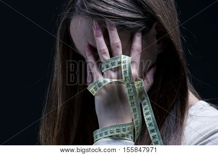 Woman Covering Her Face With A Centimeter