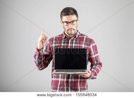 Man With Laptop Showing Attention Gesture