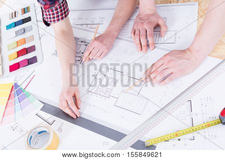Woman's And Man's Hands With Drafting Tools
