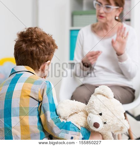 Pedagogue Talking With A Child