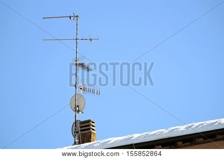 antenna tower building with the blue sky.The antenna pole in the city with the sky.The radio antenna tower in the city
