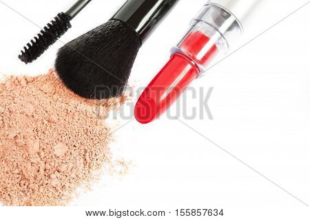 Tools and products for makeup on white background