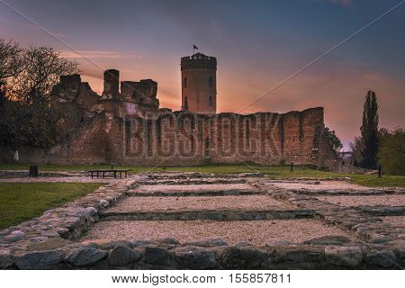 Sunset Panorama Of The Ruins Of Old Castle In Targoviste, Romania. Old Royal Court Ruins And The Roy