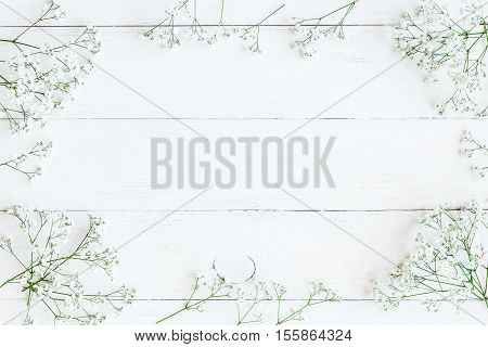 Frame made of gypsophila flowers. Winter frame. Flat lay top view