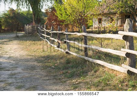 The fence in the village along the street