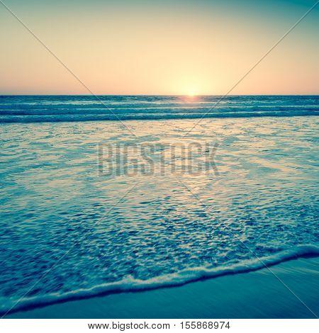 Ocean and beach at sunset. California Coast. Vintage filter soft light