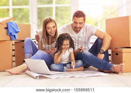 Young happy family moving into their new home