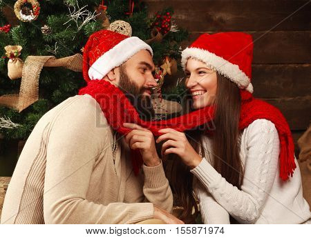 Young couple in a holiday home at Christmas celebrating happily together