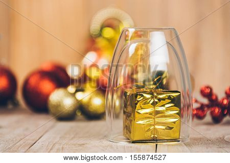 Christmas background with gift in jar and bokeh