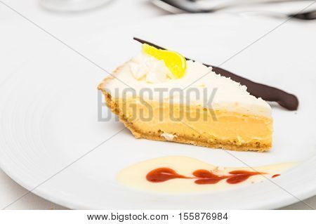 Key Lime Pie with Sauce and Knife