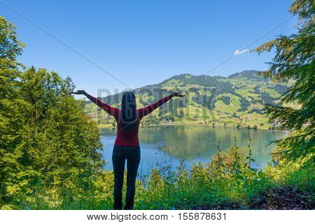 Woman on the edge. She raised her hands up in an appeal to nature.