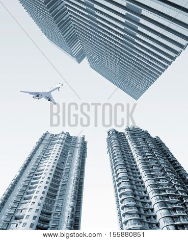 The plane flew over high-rise buildings in the city.