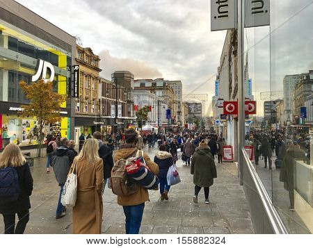 NEWCASTLE - NOVEMBER 9: Pedestrians walking through busy shopping streets in the run up to Christmas on November 9, 2016 in Newcastle, UK.