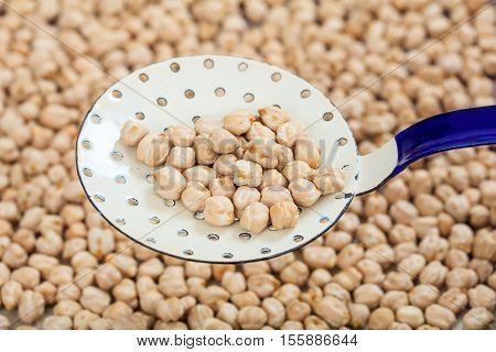 Metallic Spoon On Chick Peas Background