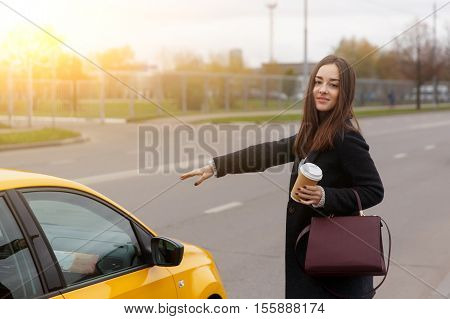 Brunette with long hair, asking taxi stop in day city