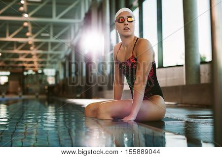 Fit Woman Resting On The Edge Of The Pool