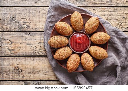 Kibbeh traditional middle eastern arabic lamb meat kofta meatball croquettes on vintage wooden table background