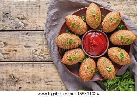 Kibbeh traditional middle eastern arabian lebanese restaurant lamb meat stuffed and bulgur kofta spicy meatball croquettes food on vintage wooden table background