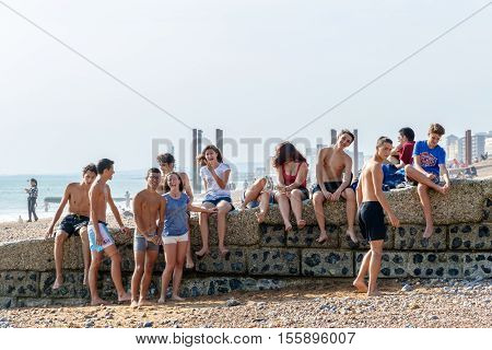 Group Of Teenagers At Brighton Beach