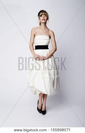 Stunning bride in white studio portrait full figur