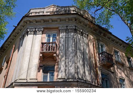 Facade Of An Old House With Balconies In The Center Of Irkutsk