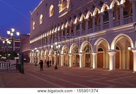 MACAU, MACAU S.A.R. - NOVEMBER 23: People move alongside the Macau Venetian casino Doge`s Palace copy on 23th of November, 2015 in Macau.