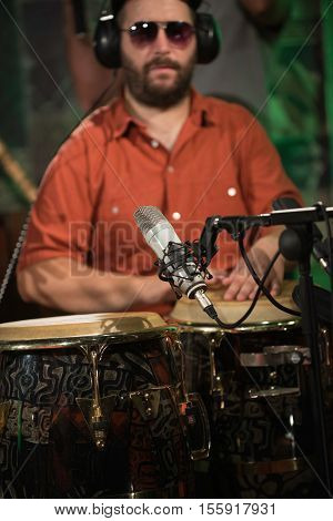 Percussionist playing drums on concert, toned image, vertical image