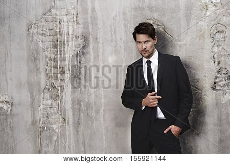 Sharp dressed guy in black suit portrait