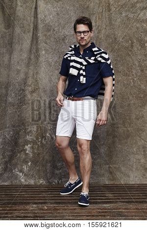 Man in stripes and shorts looking at camera