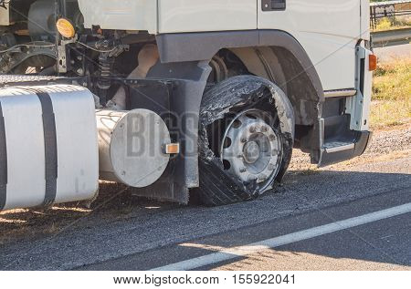 Blown truck tire after tire explosion at high speed