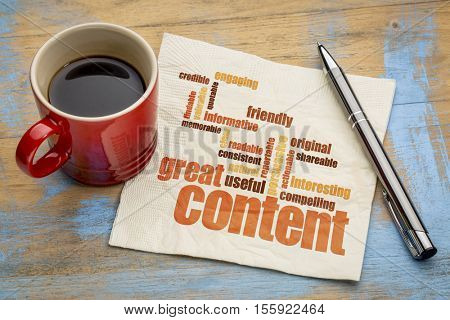 business writing and content marketing concept - great content word cloud on a napkin with a cup of coffee