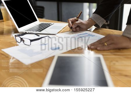 Businessman In Suit Analyse Market Analysis Business Chart With Computer And Tablet