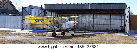 Small Plane Near Hangar