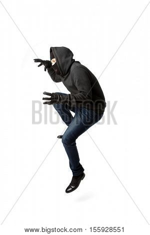 Prowling thief in black mask