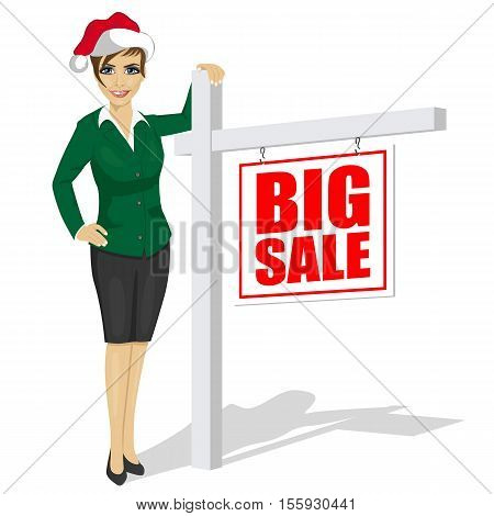 woman wearing santa hat standind next to big sale sign over white background