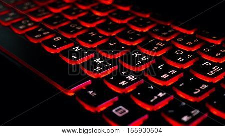 Close Up. Red Backlight, Backlit On Laptop Computer Or Keyborad Computer Of Gaming In The Dark. Comp