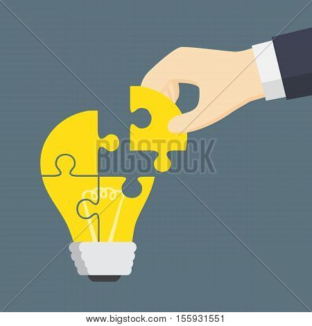 People Hand Put A Part Of Light Bulb Puzzle
