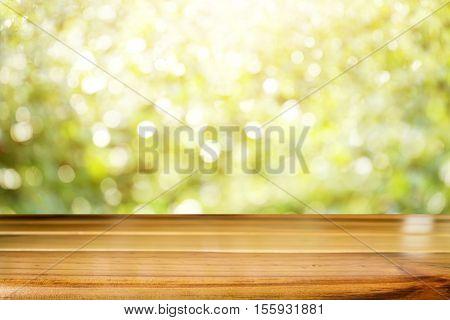 Wooden Desk Or Wooden Floor On Bokeh Background.
