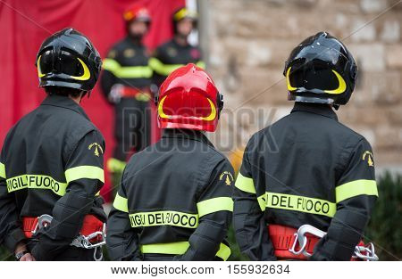 Italian firefighters with uniform and helmet during a military training