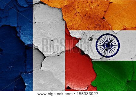 flags of France and India painted on cracked wall