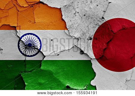 flags of India and Japan painted on cracked wall