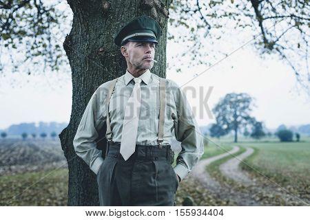 Retro 1940S Military Officer Smoking Cigarette Under Tree.