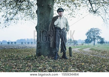 Retro 1940S Military Officer Standing Under Tree.