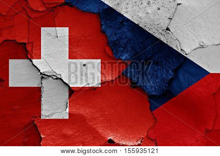 flags of Switzerland and Czechia painted on cracked wall