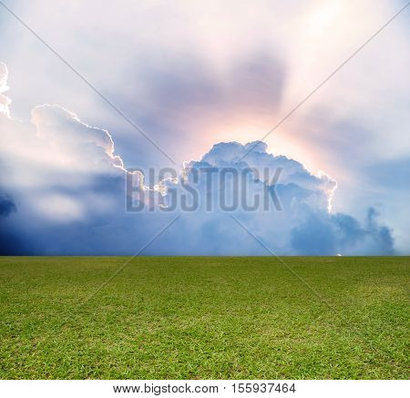 Empty green field and blue clouds sky. use for backdrop