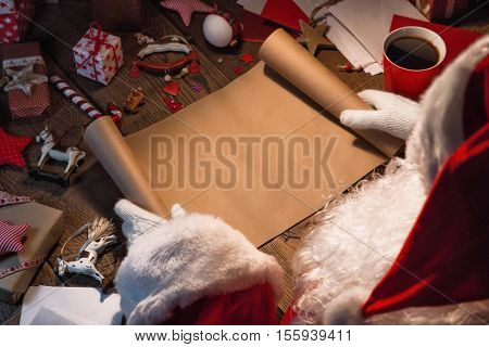 Santa Claus with gifts and wish list