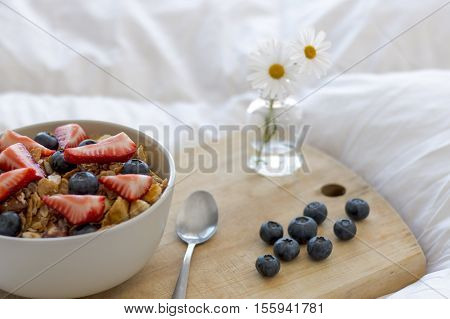 Breakfast with cereals and fruits in bed